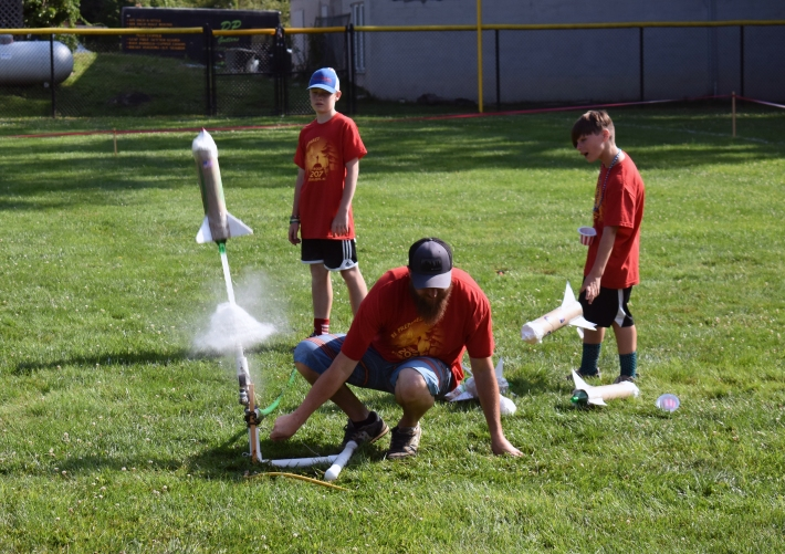 Highlands Boy Scout Troop 207 Scout master Caleb Bowers launches a handmade rocket from the ball field July 4.